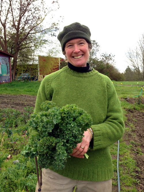 Rebecca in her spring green sweater and kale