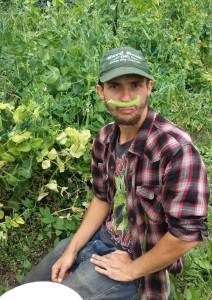 Farm Intern having fun wearing a pea mustache