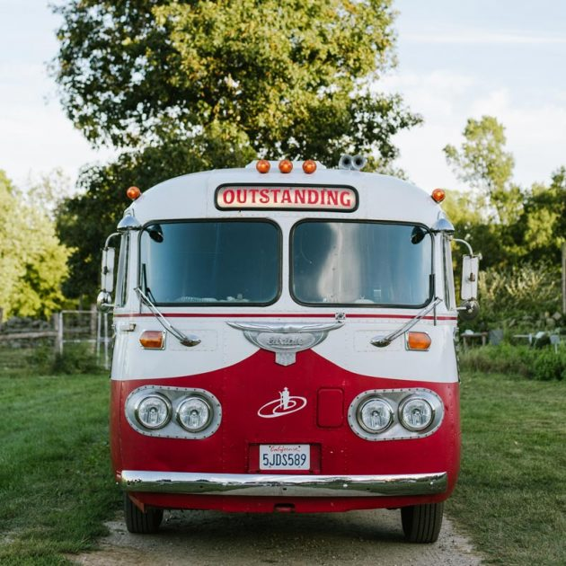 Outstanding in the Field classic red bus
