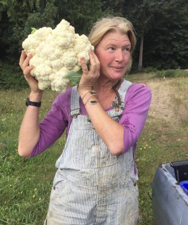 Farmer Rebecca and a HUGE cauliflower head